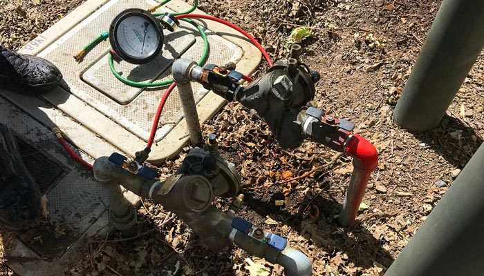 Testing a small backflow preventer on Saint Helena Highway
